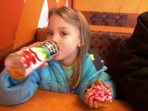 Rhiannon stuffing her face at Dunkin Donuts