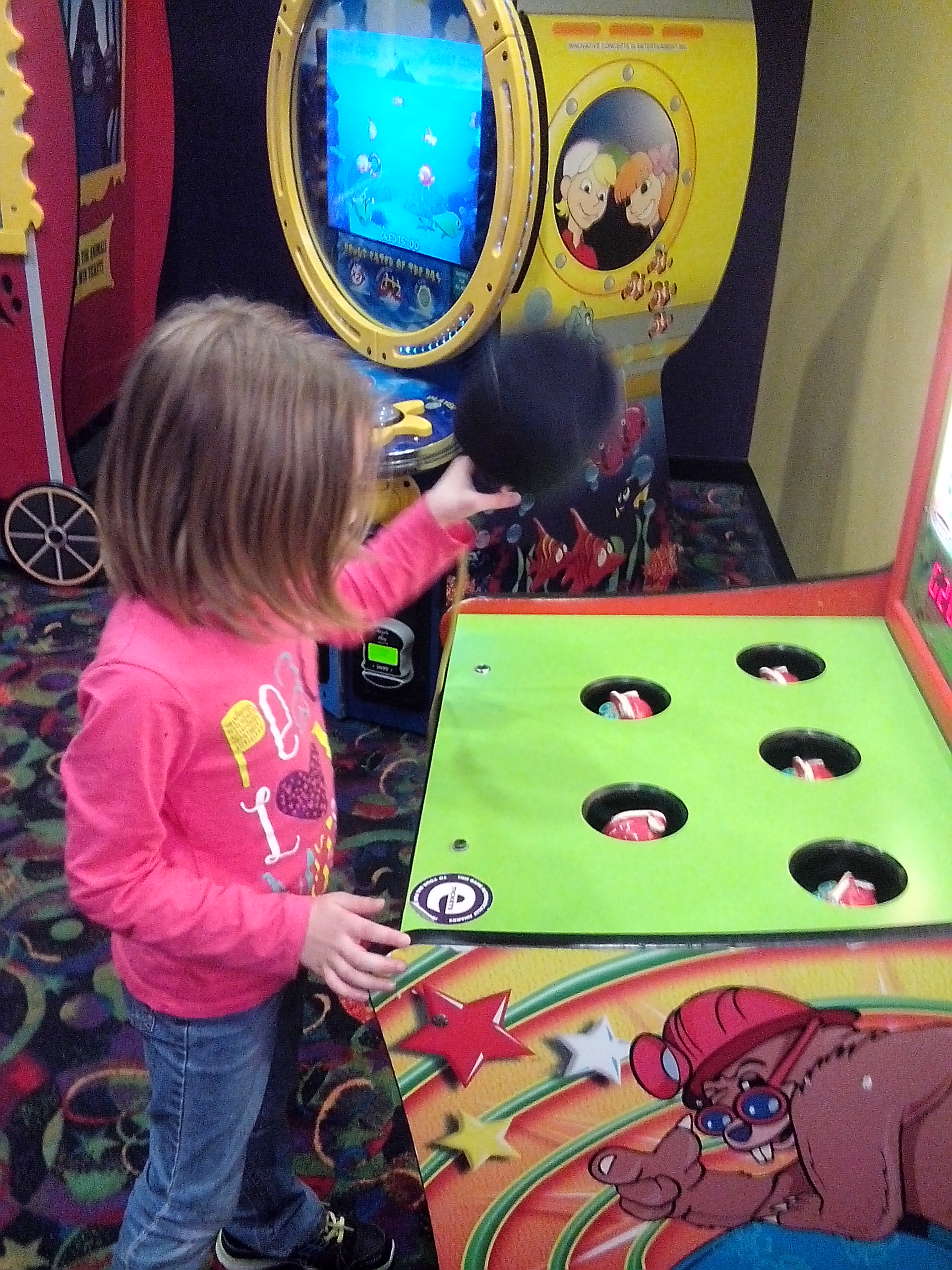 Rhi playing Games at Amazing Pizza Machine